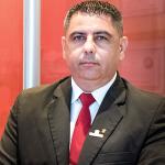 O Supervisor da Rudder Sergio Marques em frente ao estande da empresa